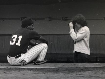 Arlene Schulman photographing New York Yankees outfielder Dave Winfield